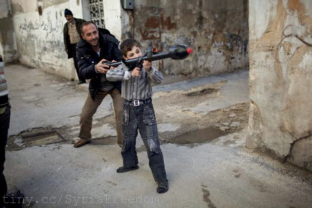 A man teaches Bilal, 11, how to use a toy rocket propelled grena