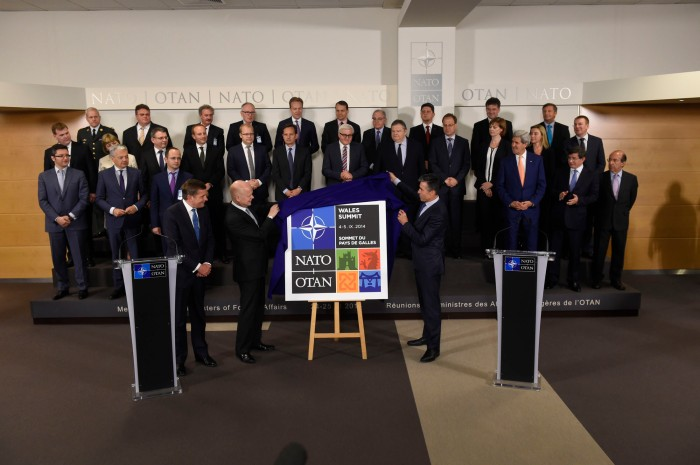 Meetings of NATO Foreign Ministers in Brussels - Unveiling of the logo for the NATO Summit, Wales 2014 and family photo of NATO Foreign Ministers