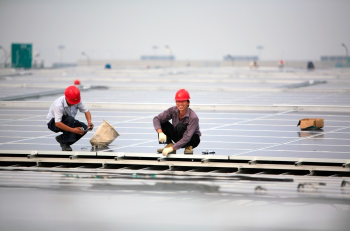 CHINA SHANGHAI HONGQIAO 19MAY10 - Installation of solar photovoltaic panels on the roofs of the Hongqiao Passenger Rail Terminal in Shanghai, China. There are a total of 23000 solar panels planned for the CECIC-funded project, each panel with a production capacity of 280 KWh to feed into the electricity grid. jre/Photo by Jiri Rezac © Jiri Rezac 2010