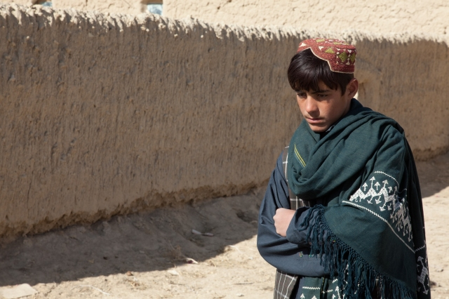 An Afghan boy walks down a street in Nyalak Kalay, Zabul province, Afghanistan, Dec. 7, 2011. First Company, 1st Kandak, 2nd Brigade, 205th Corps, Afghan National Army, conducted a dismounted patrol to the village.